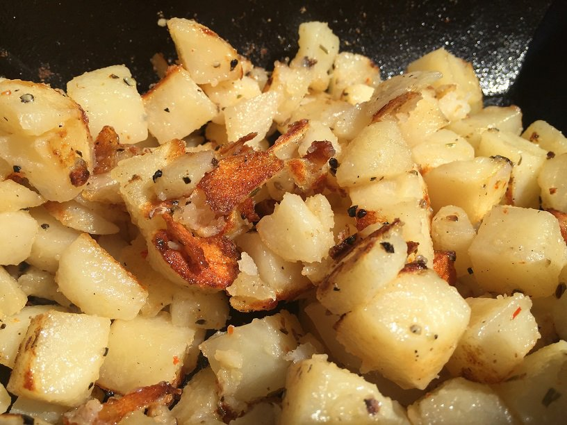 Fried potatoes on cast iron grill grate